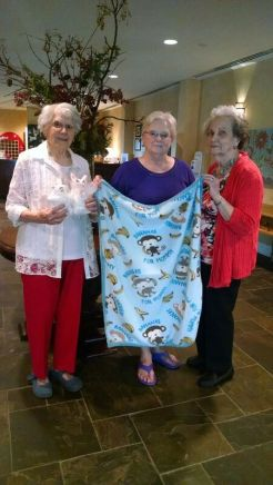 Betty Vickie and Ida holding blanket