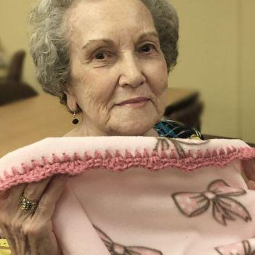 Ida Chevallier holding baby blanket