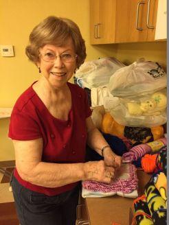 Wanda Warren tying blanket