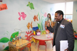 Father Emmanuel Chikezie blesses the playroom