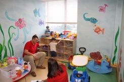 Lamar Students play with children in the new playroom