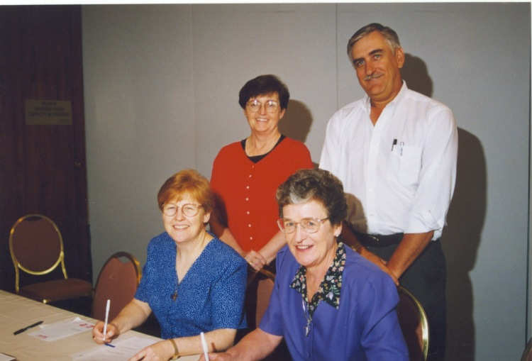 signing papers for creation of christus 1999